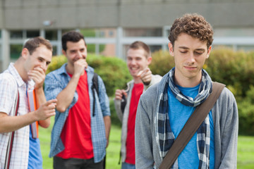Lonely student being bullied by group of brutish classmates