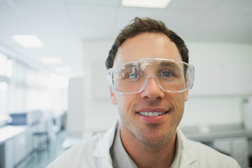 Front view of handsome young scientist wearing safety glasses