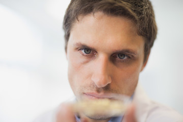 Handsome young scientist holding a petri dish