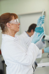 Female scientist holding an erlenmeyer flask