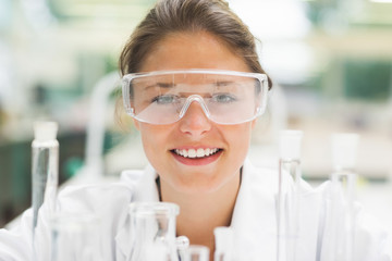 Attractive smiling student wearing safety glasses