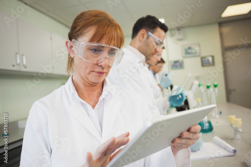 Female mature scientist working with her tablet