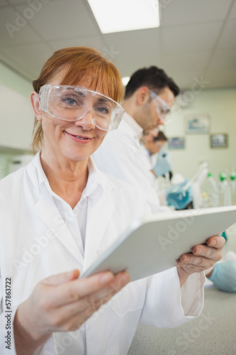 Mature female scientist holding a tablet