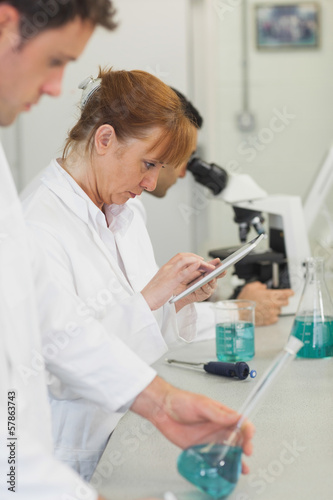 Mature female scientist working with her tablet