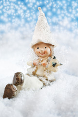 Christmas fun decorative figurines on a snowy background