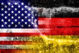 USA and Germany Flag painted on grunge wall