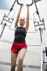 Determined slim brunette training her arms