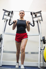 Focused woman training her arms
