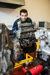 Content repairman standing behind an engine