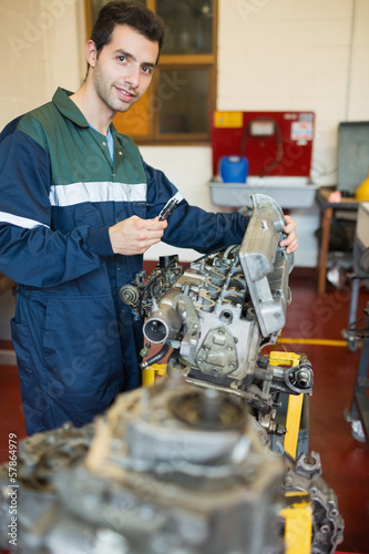 Content repairman repairing an engine