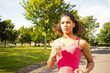 Beautiful healthy woman jogging on pathway in park