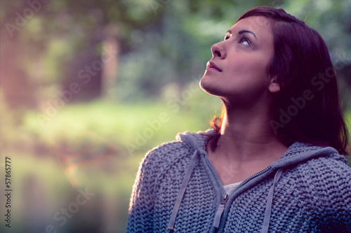 Close up of a serious woman looking up outdoors
