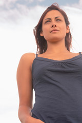 Woman in tank top against the sky