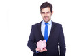 Businessman holding a piggy bank, isolated on a white background