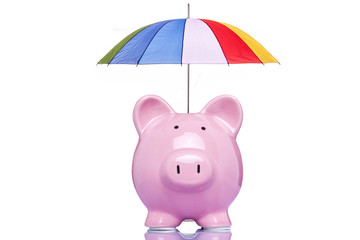 Piggy bank with a multicolored umbrella
