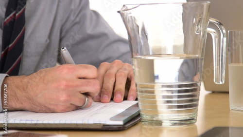 Hispanic businessman taking notes