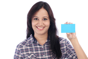 Happy young Indian girl with blank card