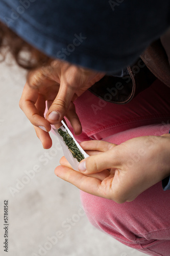 Girl rolling a joint