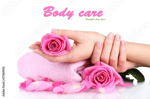 Pink towel with roses and hands isolated on white