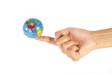 Hand holding a globe on index finger