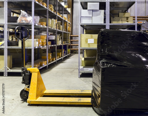 Forklift on large warehouse