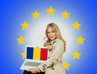 woman holding laptop with romanian flag