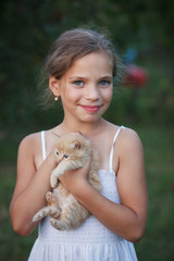 Lovely girl with cute kitten