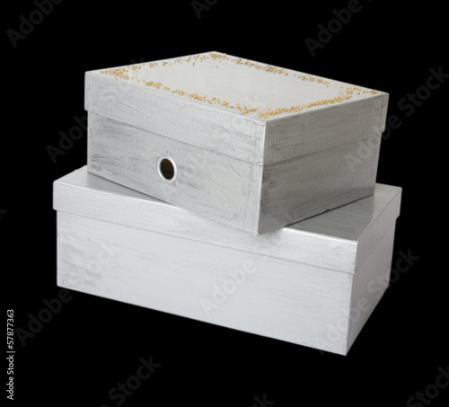 two  boxes isolated on black background