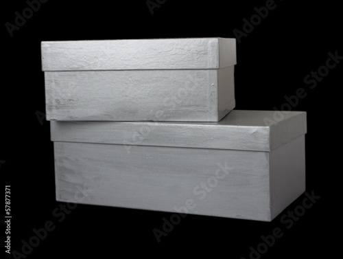 two shoe boxes isolated on black background