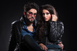 fashion couple in leather jackets posing