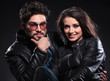 young couple in leather jackets, pensive man