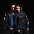 fashion woman in leather jacket standing against her boyfriend