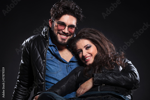 young laughing couple on a dark background