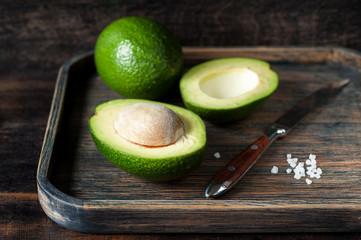Avocado in a wooden tray