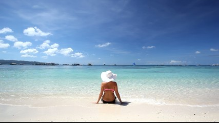 Girl in sun hat relaxing on tropical beach, Boracay