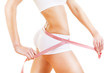 sporty woman figure with pink tapemeasure
