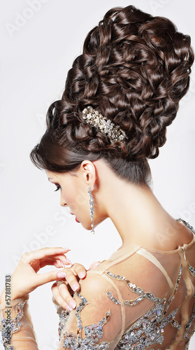 Luxury. Fashion Model with Trendy Updo - Braided Tress. Vogue