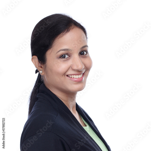 Smiling young Indian woman against white