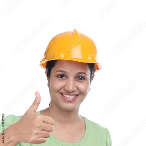 Young construction engineer with thumbs up gesture