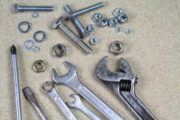 Various tools with  bolts and nuts