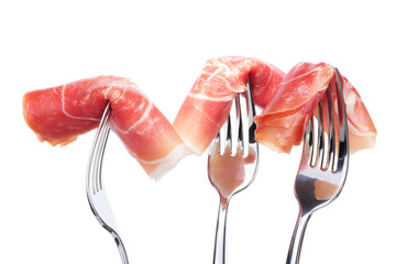 Spanish jamon on forks isolated