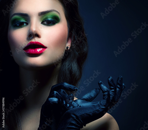 Beauty Fashion Glamour Girl. Vintage Style Model Wearing Gloves
