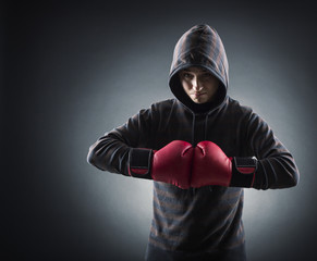 Boxer with red gloves in dark room