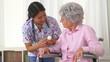 Japanese caregiver advising patient