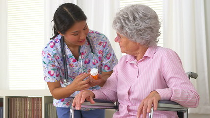 Japanese caregiver advising patient