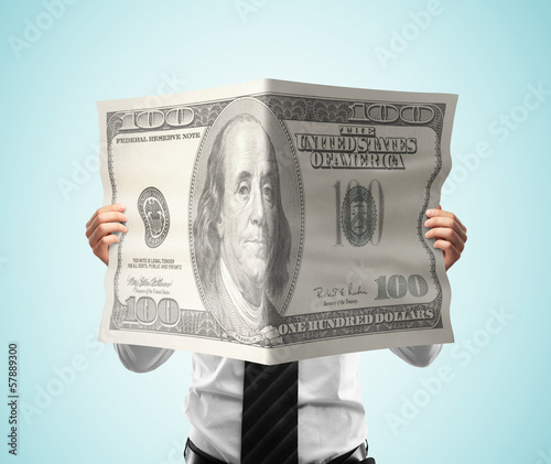 businessman reading magazine dollar