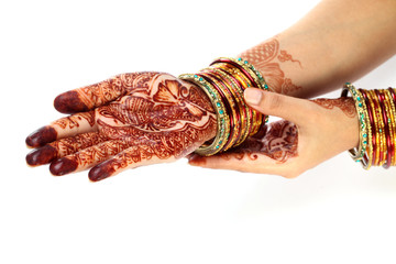Henna being applied to two hands