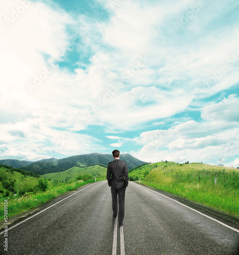 businessman walking on road