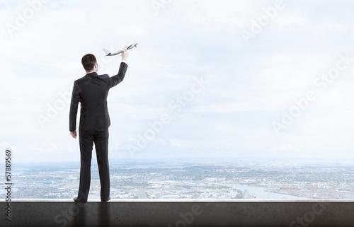 man holding airplane