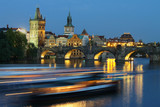 Prague cityscape with Charles bridge in the evening